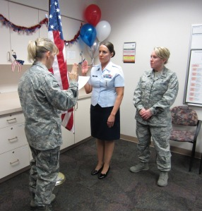 Melissa Conner, RN being sworn in by Lt. Kristi Roers (left) and Major Michelle Lambert