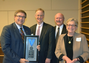 HCMC's Scott Wordelman and Dr. Jon Pryor accepted the award from UCare officials.