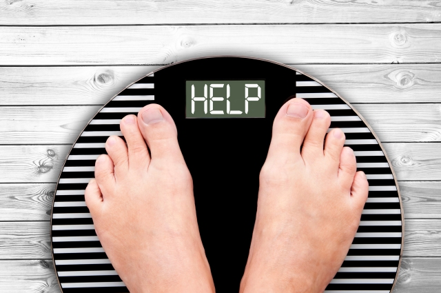 Word Help written on a weight scale